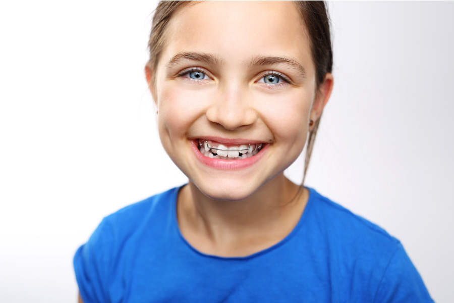 Young blue-eyed girl with early intervention braces.